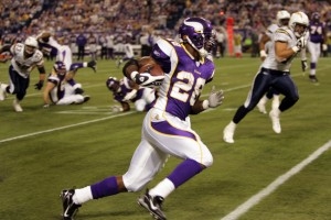 MINNEAPOLIS - NOVEMBER 4:  Adrian Peterson of the Minnesota Vikings runs for a 1st down in the 1st qtr against the San Diego Chargers on November 4, 2007, at the Metrodome in Minneapolis, Minnesota.  Minnesota won 35-17. (Photo by K.C. Alfred/Union-Tribune via Getty Images) *** LOCAL CAPTION ***