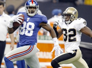 New York Giants wide receiver Hakeem Nicks (88) races with a pass in front of New Orleans Saints cornerback Jabari Greer (32) in the second half of their NFL football game in New Orleans, Sunday, Oct. 18, 2009.  The Saints defeated the Giants  48-27. (AP Photo/Bill Haber)   Original Filename: Giants_Saints_Football_LAWH114.jpg