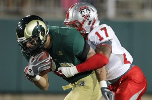 Colorado State Rams tight end Crockett Gillmore (10) is tackled by New Mexico Lobos cornerback Freddy Young (17). Credit: Troy Babbitt-US PRESSWIRE