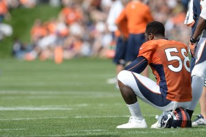 Denver Broncos outside linebacker Von Miller (58) sits on his helmet during training camp at the Broncos training facility. Mandatory Credit: Ron Chenoy-USA TODAY Sports
