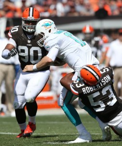 Cleveland Browns linebacker Craig Robertson (53) sacks Miami Dolphins quarterback Ryan Tannehill (17) as Cleveland Browns defensive tackle Billy Winn (90) closes in during the first quarter at FirstEnergy Field. Mandatory Credit: Ron Schwane-USA TODAY Sports