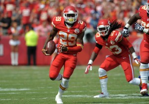 Kansas City Chiefs strong safety Eric Berry (29) runs for yardage after recovering a fumble from Dallas Cowboys running back Lance Dunbar (25) (not pictured) during the second half at Arrowhead Stadium. The Chiefs won 17-16. Mandatory Credit: Denny Medley-USA TODAY Sports