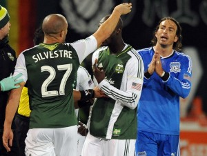 Portland Timbers defender Mikael Silvestre (27) argues with San Jose Earthquakes forward Alan Gordon (24) after elbowing Silvestre in the mouth during the second half of the game at Jeld-Wen Field. Gordon was given a red card on the play and ejected from the game. The Timbers won the game 1-0. Mandatory Credit: Steve Dykes-USA TODAY Sports