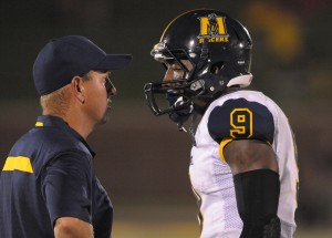 Murray State Racers head coach Chris Hatcher talks with wide receiver Walter Powell (9) in a time out during the second half of the game against the Missouri Tigers at Faurot Field. Missouri won 58-14. Mandatory Credit: Denny Medley-USA TODAY Sports
