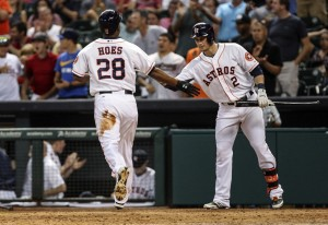 Houston Astros right fielder L.J. Hoes (28) is congratulated by center fielder Brandon Barnes (2) after scoring a run during the sixth inning against the Cincinnati Reds at Minute Maid Park. Mandatory Credit: Troy Taormina-USA TODAY Sports