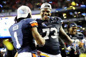 Auburn Tigers wide receiver Trovon Reed (1) and Auburn Tigers offensive linesman Greg Robinson (73) celebrate after the 2013 SEC Championship game against the Missouri Tigers at Georgia Dome. The Auburn Tigers defeated the Missouri Tigers 59-42. Mandatory Credit: Kevin Liles-USA TODAY Sports