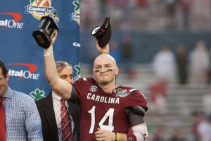 South Carolina Gamecocks quarterback Connor Shaw (14) accepts the MVP trophy after defeating the Wisconsin Badgers in the Capital One Bowl at the Florida Citrus Bowl. Mandatory Credit: Rob Foldy-USA TODAY Sports