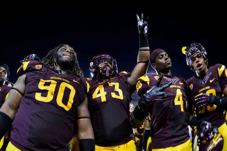 Arizona State Sun Devils defensive tackle Will Sutton (90), defensive end Davon Coleman (43), safety Alden Darby (4) and linebacker Brandon Matthew (50) celebrate after beating the Utah Utes 37-7 at Sun Devil Stadium. Mandatory Credit: Matt Kartozian-US PRESSWIRE