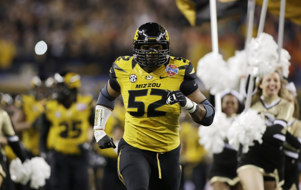 Missouri Tigers defensive lineman Michael Sam (52) runs on the field before the game against the Oklahoma State Cowboys at the 2014 Cotton Bowl at AT&T Stadium. Missouri beat Oklahoma State 41-31. Mandatory Credit: Tim Heitman-USA TODAY Sports