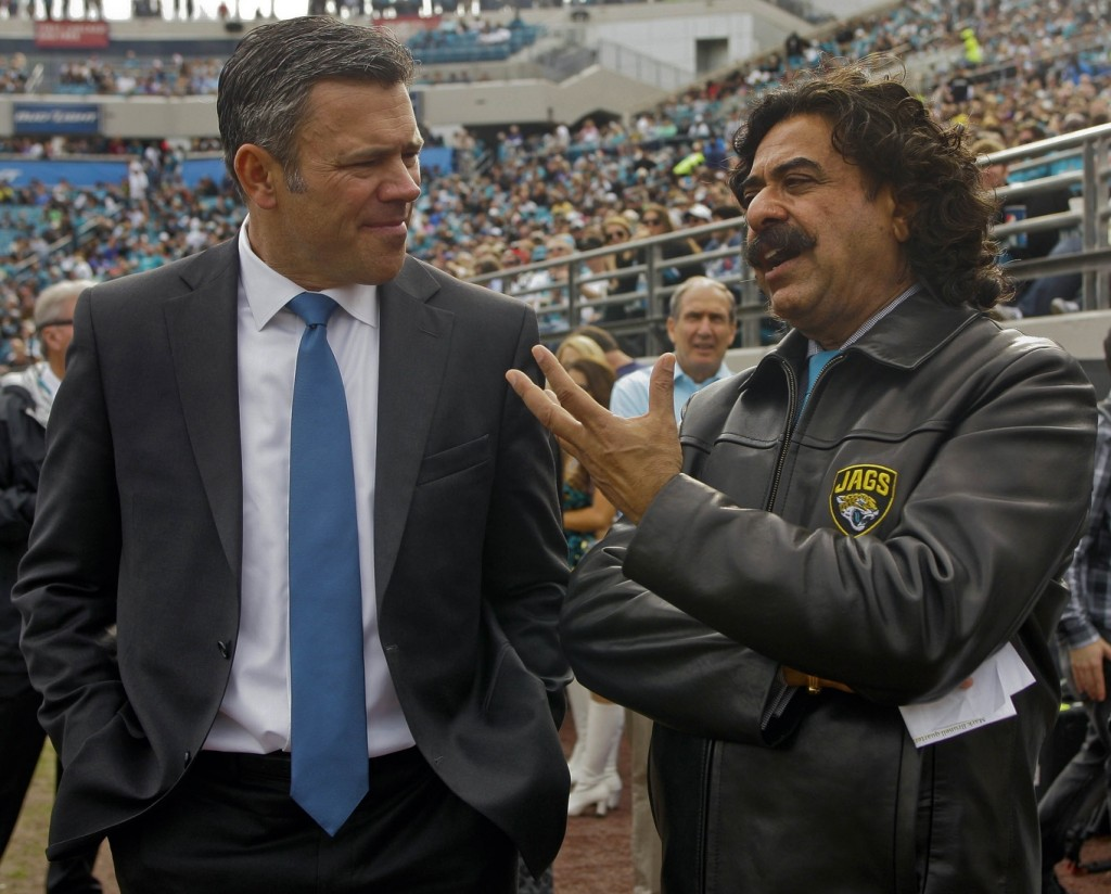 "Former Jacksonville Jaguars quarterback Mark Brunell speaks with Jacksonville Jaguars owner Shad Khan in the second quarter of their game against the Buffalo Bills at EverBank Field. Brunell was inducted into the ""Pride of the Jaguars"" during halftime ceremonies. Photo Credit: Phil Sears-USA TODAY Sports"