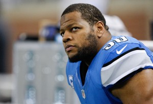 Detroit Lions defensive tackle Ndamukong Suh (90) sits on the bench before the game against the New York Giants at Ford Field. Giants beat the Lions 23-20. Mandatory Credit: Raj Mehta-USA TODAY Sports