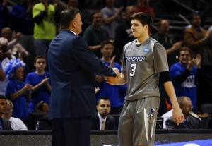 Creighton Bluejays head coach Greg McDermott embraces forward Doug McDermott (3) after they lost to the Baylor Bears in a men's college basketball game during the third round of the 2014 NCAA Tournament at AT&T Center. Photo Credit: Kevin Jairaj-USA TODAY Sports