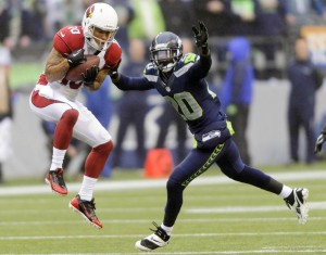 Arizona Cardinals wide receiver Brittan Golden (10) catches a pass over Seattle Seahawks cornerback Jeremy Lane (20) during the first half at CenturyLink Field. Mandatory Credit: Steven Bisig-USA TODAY Sports