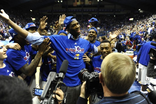 Kansas Jayhawks center Joel Embiid (center) celebrates after the game against the Texas Tech Red Raiders at Allen Fieldhouse. Kansas won the game 82-57. Mandatory Credit: John Rieger-USA TODAY Sports