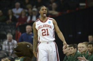 Oklahoma Sooners forward Cameron Clark (21) reacts in the first half of a men's college basketball game during the second round of the 2014 NCAA Tournament against the North Dakota State Bison at Veterans Memorial Arena. Mandatory Credit: Kirby Lee-USA TODAY Sports