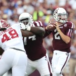 Texas A&M Aggies quarterback Johnny Manziel (2) throws in the pocket as guard Germain Ifedi (74) blocks against Alabama Crimson Tide defensive end Ed Stinson (49) at Kyle Field. Mandatory Credit: Matthew Emmons-USA TODAY Sports