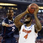 Florida Gators center Patric Young (4) goes up for a shot against Connecticut Huskies forward DeAndre Daniels (2) in the second half during the semifinals of the Final Fou
