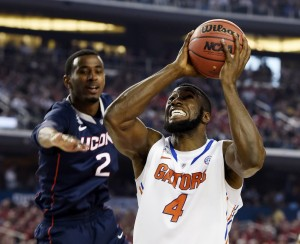 Florida Gators center Patric Young (4) goes up for a shot against Connecticut Huskies forward DeAndre Daniels (2) in the second half during the semifinals of the Final Four in the 2014 NCAA Mens Division I Championship tournament at AT&T Stadium. Mandatory Credit: Robert Deutsch-USA TODAY Sports