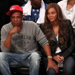 Recording artists Beyonce and Jay-Z take in the Toronto Raptors at the Brooklyn Nets game six of the first round of the 2014 NBA Playoffs at Barclays Center. Mandatory Credit: Adam Hunger-USA TODAY Sports
