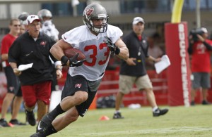 Running back Peyton Hills (33) runs with the ball during training camp at One Buccaneer Place. Mandatory Credit: Kim Klement-USA TODAY Sports