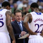 Kansas Jayhawks head coach Bill Self talks to forward Tarik Black (25) and guard Andrew Wiggins (22) in a timeout during the second half against the Oklahoma State Cowboys in the second round of the Big 12 Conference college basketball tournament at Sprint Center. Kansas won 77-70 in overtime. Mandatory Credit: Denny Medley-USA TODAY Sports