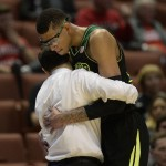 Baylor Bears center Isaiah Austin (21, right) hugs head coach Scott Drew (left) during the second half in the semifinals of the west regional of the 2014 NCAA Mens Basketball Championship tournament against the Wisconsi