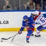 New York Rangers defenseman Dan Girardi (5) battles for the puck with Montreal Canadiens left wing Max Pacioretty (67) during the first period in game four of the