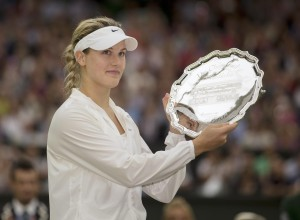 Eugenie Bouchard (CAN) holds up the runner-up trophy after her match against Petra Kvitova (CZE) on day 12 of the 2014 Wimbledon Championships at t
