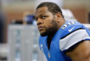 Detroit Lions defensive tackle Ndamukong Suh (90) sits on the bench before the game against the New York Giants at Ford Field. Giants beat the Lions 23-20. Mandatory Credit: Raj Mehta-USA T