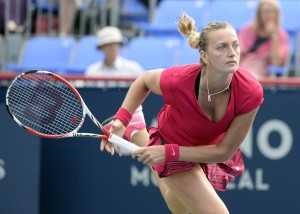 Petra Kvitova (CZE) serves to Ekaterina Makarova (RUS) on day four of the Rogers Cup tennis tournament at Uniprix Stadium. Mandatory Credit: Eric Bolte-USA TODAY Sports
