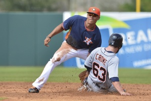 Houston Astros shortstop Carlos Correa (84) tags out Detroit Tigers left fielder Trevor Crowe (63) on a stolen base attempt during the third inning at Osceola County Stadium. Mandatory Credit: Tommy Gilligan-USA TODAY Sports