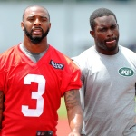 quarterback Tajh Boyd (3) and New York Jets quarterback Michael Vick (right) walk to the locker room following training camp at SUNY Cortland. Mandatory Credit: Rich Barnes-USA TODAY Sports