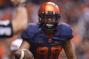 Syracuse Orange wide receiver Jarrod West (88) looks to hand the ball back to a referee after completing a play during the second quarter of a game against the Louisville Cardinals at the Carrier Dome. Louisville won the game 28-6. Mandatory Credit: Mark Konezny-USA TODAY Sports