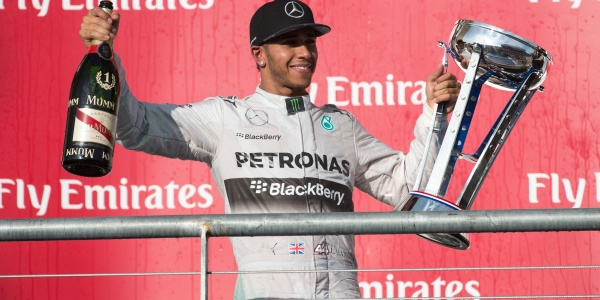 Mercedes driver Lewis Hamilton (44) of Great Britain celebrates winning the 2014 U.S. Grand Prix at Circuit of the Americas. Mandatory Credit: Jerome Miron-USA TODAY Sports