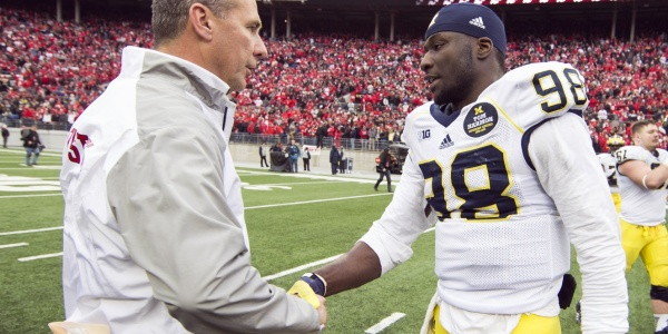 Ohio State Buckeyes head coach Urban Meyer and Michigan Wolverines quarterback Devin Gardner (98) shake hands after the game at Ohio Stadium. Ohio State won the game 42-28. Mandatory Credit: Greg Bartram-USA TODAY Sports
