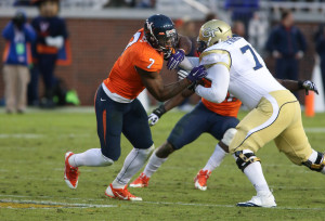 Nov 1, 2014; Atlanta, GA, USA; Virginia Cavaliers defensive end Eli Harold (7) is shown during a play against Georgia Tech Yellow Jackets offensive lineman Eason Fromayan (79) in their game at Bobby Dodd Stadium. Georgia Tech won 35-10. Mandatory Credit: Jason Getz-USA TODAY Sports