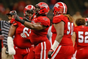 Louisiana-Lafayette Ragin Cajuns defensive lineman Christian Ringo (9) celebrates after a sack with teammates defensive lineman Justin Hamilton (6) and defensive tackle Jacoby Briscoe (90) during the second half of the New Orleans Bowl against the Nevada Wolf Pack at the Mercedes-Benz Superdome. Louisiana-Lafayette defeated Neveda 16-3. Mandatory Credit: Derick E. Hingle-USA TODAY Sports