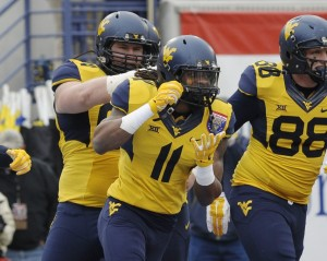 West Virginia Mountaineers wide receiver Kevin White (11) celebrates after scoring a touchdown during the game against the Texas A&M Aggies in the 2014 Liberty Bowl at Liberty Bowl Memorial Stadium. Mandatory Credit: Justin Ford-USA TODAY Sports