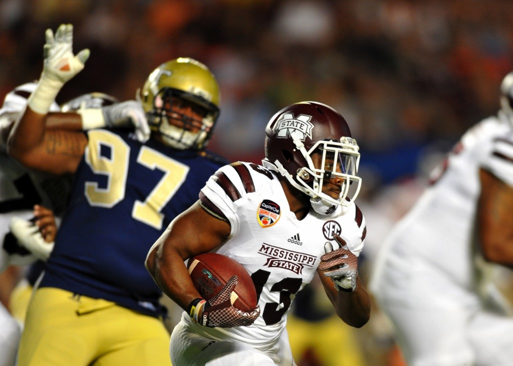 Mississippi State Bulldogs running back Josh Robinson (13) runs past Georgia Tech Yellow Jackets defensive lineman Shawn Green (97) during the first quarter in the 2014 Orange Bowl at Sun Life Stadium. Mandatory Credit: Steve Mitchell-USA TODAY Sports