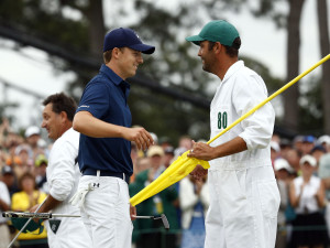 Jordan Spieth hugs caddie Michael Greller after winning the final round of The Masters golf tournament at Augusta National Golf Club. Mandatory Credit: Rob Schumacher-USA TODAY Sports