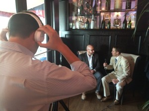 Adam White (right) conducting an interview at #SBWeek 2015 in Miami