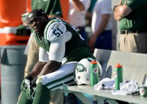 New York Jets linebacker IK Enemkpali (51) takes a breather on the bench during the second half against the Miami Dolphins at Sun Life Stadium. Mandatory Credit: Steve Mitchell-USA TODAY Sports