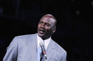Charlotte Bobcats owner Michael Jordan unveils the new Charlotte Hornets logo at halftime during the game against the Utah Jazz at Time Warner Cable Arena. Mandatory Credit: Sam Sharpe-USA TODAY Sports